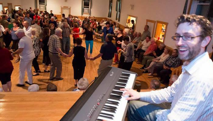 Mac Morin plays piano at a square  dance in Brookvillage, Inverness County: View our Gaelic Events Calendar